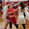 Natalie Harmon splits two defenders on her way to the basket during Mankato West's game against Jordan on Tuesday. Photo by Jackson Forderer