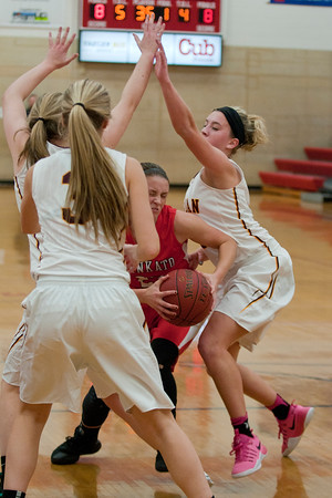 Ashley Gustavson is double teamed by two Jordan defenders in the first half of play on Tuesday evening. Photo by Jackson Forderer