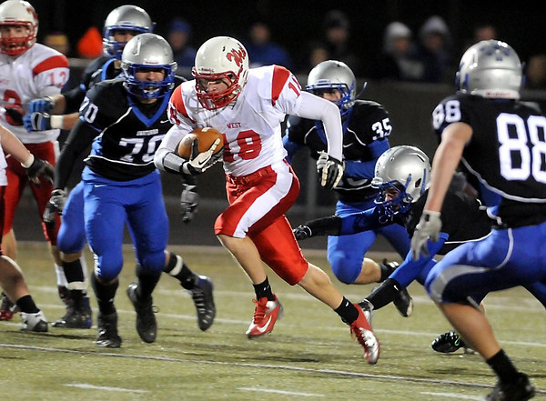 Mankato West's Connor Watts finds a hole in the Owatonna secondary during their State Class AAAAA quarterfinal game Friday at Lakeville North High School.