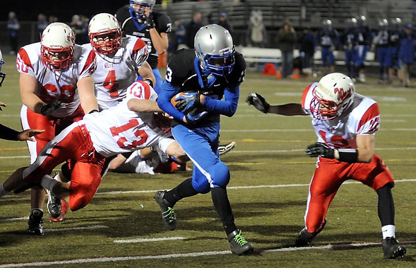 Owatonna's Aaron Peterson finds the end zone ahead of the tackle by Manakto West's Alex Knutson (13) and Josh Athey (12) during their State Class AAAAA quarterfinal game Friday at Lakeville North High School.