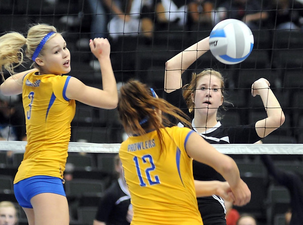 Belle Plaine's Marykay Nasby watches as Thief River Falls' Brooke Yaggie (3) and Crystal Amundson (12) play the ball at the net during their State Class AA quarterfinal match Thursday at the Xcel Energy Center in St. Paul.