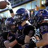 Minnesota State University's Adam Thielen celebrates with teammates Robert Gunderson (31) and Tyler Henderson (33) after scoring a touchdown during the first half against Upper Iowa Saturday at Blakeslee Stadium.