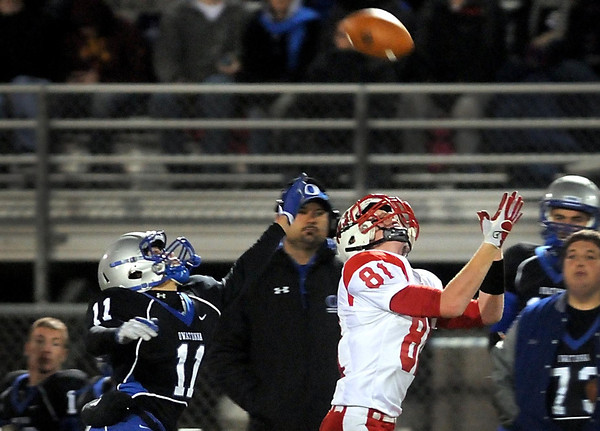 Owatonna's Sam Fenske pursues Mankato West's Will Claussen as he tries to bring in a long pass during their State Class AAAAA quarterfinal game Friday at Lakeville North High School.