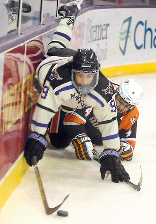 Pat Christman<br /> Minnesota State's Bryce Gervais is tripped up by Bowling Green's Mike Sullivan during the second period Saturday at the Verizon Wireless Center.