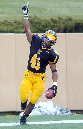Pat Christman<br /> Gustavus Adolphus College running back Jeff Dubose celebrates a touchdown against Carleton Saturday at Hollingsworth Field.