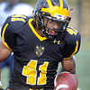 Pat Christman<br /> Gustavus Adolphus College running back Jeff Dubose runs for extra yards during the first half against Carleton College Saturday at Hollingsworth Field. Dubose set a school record Saturday for most touchdowns in a season.