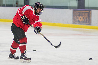 Mankato West's Courtney Bloemke takes a shot on goal during Tuesday's practice at the All Season Arena. Bloemke is one of the captains for this year's Scarlets girls hockey team. Photo by Jackson Forderer