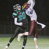 Pipestone Area's Tyl Woelber (20) tips a pass away from Blue Earth Area's Blake Barnett in the first half of Friday's state quarterfinal game played in New Ulm. Photo by Jackson Forderer