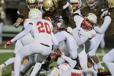Mankato West defenders, including Jayden Hatkin (20) try to tackle Apple Valley's Damian Swanson. Photo by Jackson Forderer