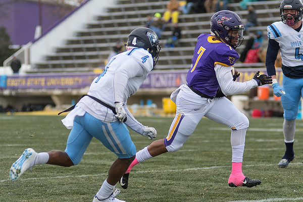 Minnesota State's JD Ekowa rushes past Upper Iowa's Nicolas Corley for one of the Maverick's scores in the first half. The Mavericks won the game 47-7 to finish the regular season undefeated. Photo by Jackson Forderer