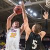 Minnesota State's Jake Guse puts up a shot against Lindenwood's Drew Moore in the first half of Friday's game. The Mavericks won a back and forth contest 88-85. Photo by Jackson Forderer