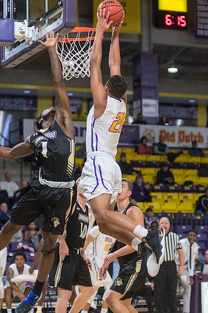 Minnesota State's Cameron Kirksey soars past Lindenwood's TJ Crockett after getting a pass from Tre Baumgardner in the second half of Friday's game played at Bresnan Arena. MSU won their home season opener against Lindenwold 88-85. Photo by Jackson Forderer