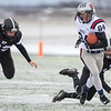United South Central's Colby Klocek rushes past Blooming Prairie's Carson Brennecke (left) and Cole Christianson after catching a pass in the second half of Saturday's Class A state quarterfinal game played in New Ulm. USC lost the contest 42-0. Photo by Jackson Forderer