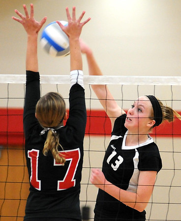 Martin Luther College's Rebecca Engelbrecht tries to hit the ball past the block of Bethany Lutheran College's Caitlin Decker during their match Wednesday in Mankato.