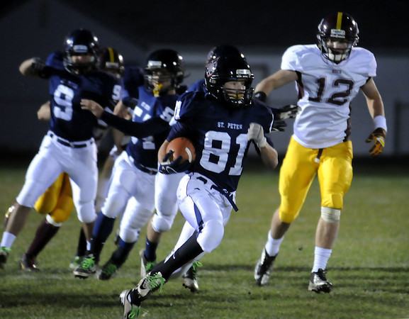 John Cross<br /> St. Peter's Jordon Sorensen returns a kick-off 82 yards for a touchdown against Blue Earth Area during the Saints first possession of the game.
