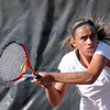 Mankato West No. 1 singles player Andrea Erdman returns a volley during her match against Mankato East's Libby Andrego Wednesday at the West courts.