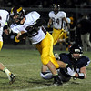John Cross<br /> Blue Earth Area's Kysten Zierke is tripped up at the line of scrimmage by St. Peter's Dylan Connor.
