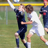Pat Christman <br /> Mankato Loyola/Lake Crystal Wellcome Memorial's Luke VanBlarcom defends St. Peter's Ryan Van Rossum during the first half Saturday at the Good Counsel field.
