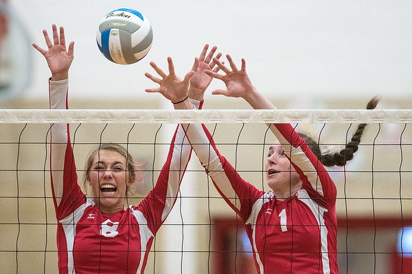 Lauren Marzolf (8) and Ellie Blackman (1) of Mankato West attempt to block a spike hit by a Red Wing player in Thursday's match. Photo by Jackson Forderer
