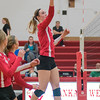 Mankato West's Kennedy Geller tips the ball over the net in Thursday's match against Red Wing. Photo by Jackson Forderer