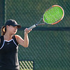 Hannah Weng of Mankato East returns a forehand to her opponent Anna Kill of Worthington in the No. 1 single's match. East defeated Worthington 6-1 to advance in the Section 2AA team tournament. Photo by Jackson Forderer