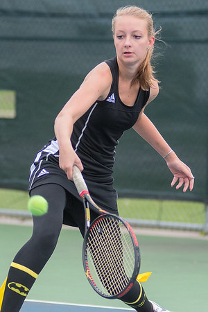 Mankato East's Alli Kleinschmidt reaches for a one-handed backhand during the number four singles match against New Ulm on Thursday. Photo by Jackson Forderer
