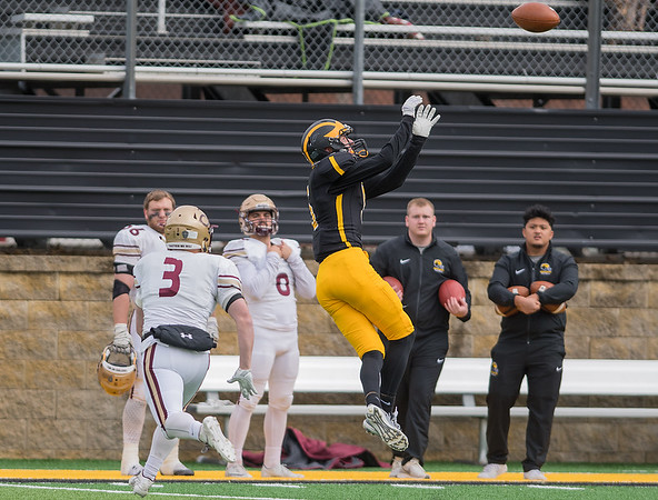 Gustavus wide receiver Brice Panning goes up to make a catch while being defended by Concorida Moorhead's Trenton Austvold in the second half of Saturday's game. The Gusties survived a late comeback attempt from the Cobbers and won the game 27-14. Photo by Jackson Forderer