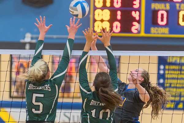 Gabrielle Straub of Le Sueur-Henderson (right) tips the ball past Waterville-Elysian-Morristown blockers Delaney Donahue (5) and Addie Atherton (10) in the second game of Tuesday's match played in Le Sueur. Photo by Jackson Forderer