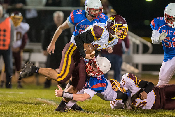 Brayden Beede of Medford tries to elude a tackle by St. Clair/Loyola's Derik Miller during the first half of play on Friday evening.  Photo by Jackson Forderer