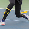 Alli Kleinschmidt of Mankato East wore Batman socks with small capes during her number four singles match on Thursday. Her parents gave the socks to her as a birthday present on Wednesday. Photo by Jackson Forderer