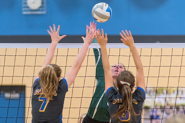 Waterville-Elysian-Morristown's past Le Sueur-Henderson's Gabrielle Straub (7) and Mia Preuhs in the third game of Tuesday's match played in Le Sueur. WEM won the match in three straight games, 25-21, 25-18 and 25-13. Photo by Jackson Forderer