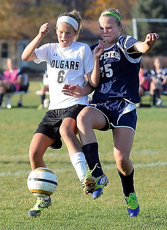 East's Taylor Kuechle and St. Peter's Halla Dontje-Lindell battle for the ball.