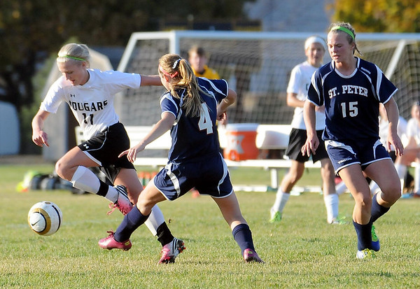 East's Marta Anderson trys to get past St. Peter's Sara Osborne (center) and Halla Dontje-Lindell.