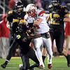 Mankato West's Trenton Marks breaks the tackle of Mankato East's Walabu Bati during the first half Wednesday at Blakeslee Stadium.