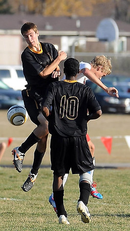 East's Brandon Sloniker and West's Michael Weber go airborne as East's Mohamud watches.