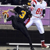 Mankato West's Will Claussen knocks the ball away from Mankato East receiver Walabu Bati during the first half Wednesday at Blakeslee Stadium. Claussen was called for pass interference on the play.