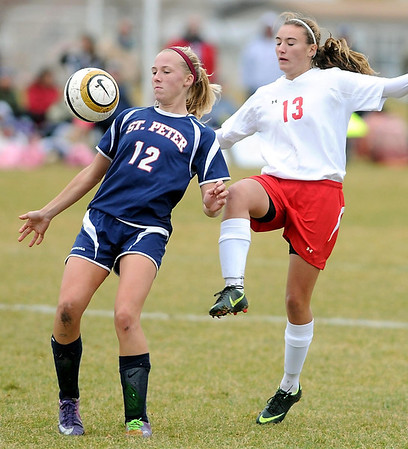St. Peter's Marta Springer keeps the ball away from Mankato West's Aisha Abdo during the Section 2A championship game Thursday at the Dakota Meadows Middle School fields.