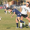 St. Peter's Sally Morrow and East's Emily Lind collide while going for the ball.