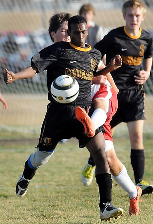 East's Mohamud Ahmed and Weest's Kyle Sandmann battle for ball control.