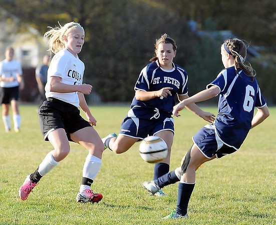 East's Marta Anderson and St. Peter's Danielle Joyal (center) and Taylor Kuechle converge on the ball.