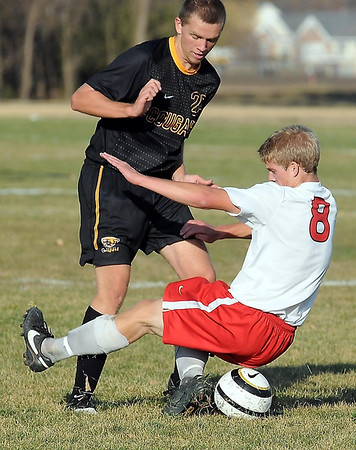 West's Garrett Meier and East's Nick Dahman get tangled up while battling for ball control.