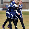 St Peter's Emily Lind is congratulated by teammate Haley Jaeger after scoring what would be the game winning goal against Mankato West in the Section 2A championship game Thursday at the Dakota Meadows Middle School fields.