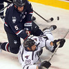 Pat Christman<br /> Minnesota State's Dylan Margonari is knocked to the ice by University of Connecticut's Jacob Poe after taking a shot during the first period Friday at the Verizon Wireless Civic Center.