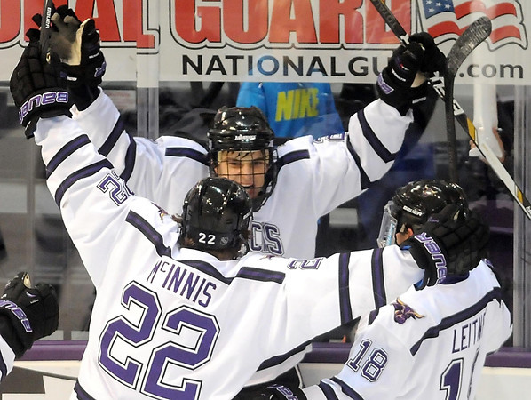 Pat Christman<br /> Minnesota State's Teddy Blueger, center, celebrates with teammates Johnny McInnis (22) and Matt Leitner (18) after scoring a goal during the first period Friday.