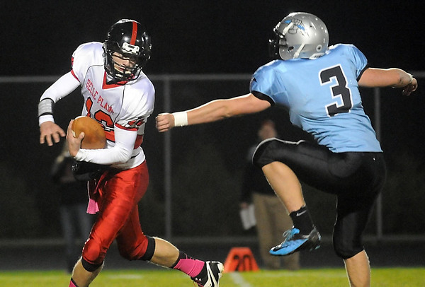 Pat Christman <br /> Tri City United's Charley Simonette (3) can't quite reach Belle Plaine quarterback Luke Narveson (12) during the first half Wednesday in Montgomery.