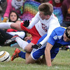 Pat Christman<br /> Mankato West's Dillon Lambert falls on top of Waseca's Andy Haley during their Section 2A championship game Thursday at the Dakota Meadows field.