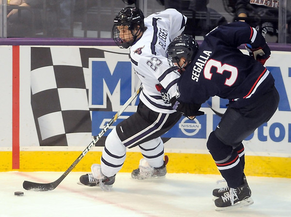 Pat Christman<br /> Minnesota State's Teddy Blueger holds off University of Connecticut's Ryan Segalla during the first period Saturday at the Verizon Wireless Center.