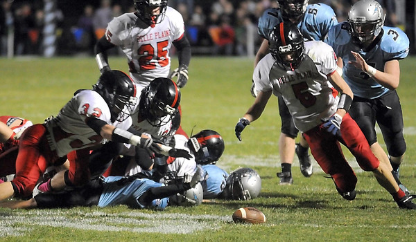 Pat Christman <br /> Belle Plaine players dive for a Tri City United fumble during the first half Wednesday in Montgomery. Belle Plaine recovered the fumble.