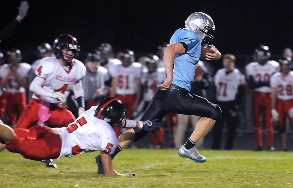 Pat Christman <br /> Belle Plaine's Zach Bahr (5) dives but can't reach Tri City United running back John Christian as he runs for his second touchdown of the first half Wednesday in Montgomery.