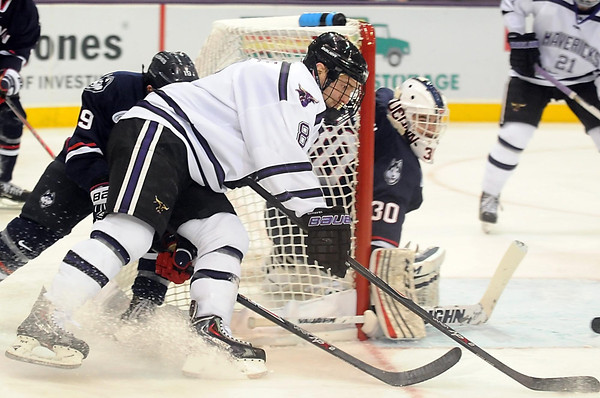 Pat Christman<br /> Minnesota State's Max Gaede swings around the back of the net behind University of Connecticut goalie Matt Grogan during Friday's game.